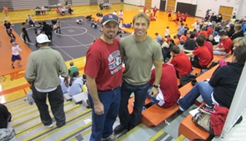 Picture of Roy Moranz and Frank Moranz at wrestling match.