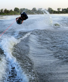 Picture of Roy Moranz knee boarding flip in the Missour River.