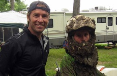 Picture of Roy Moranz and Kevin Moranz, post muddy motocross race.