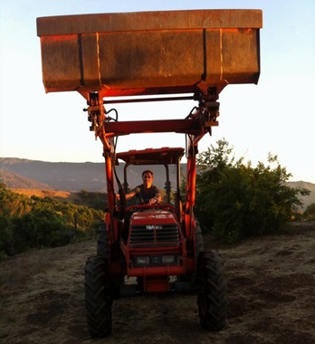 Picture of Roy Moranz on tractor.