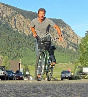 Picture of Roy Moranz riding a beach cruiser in Crested Butte.